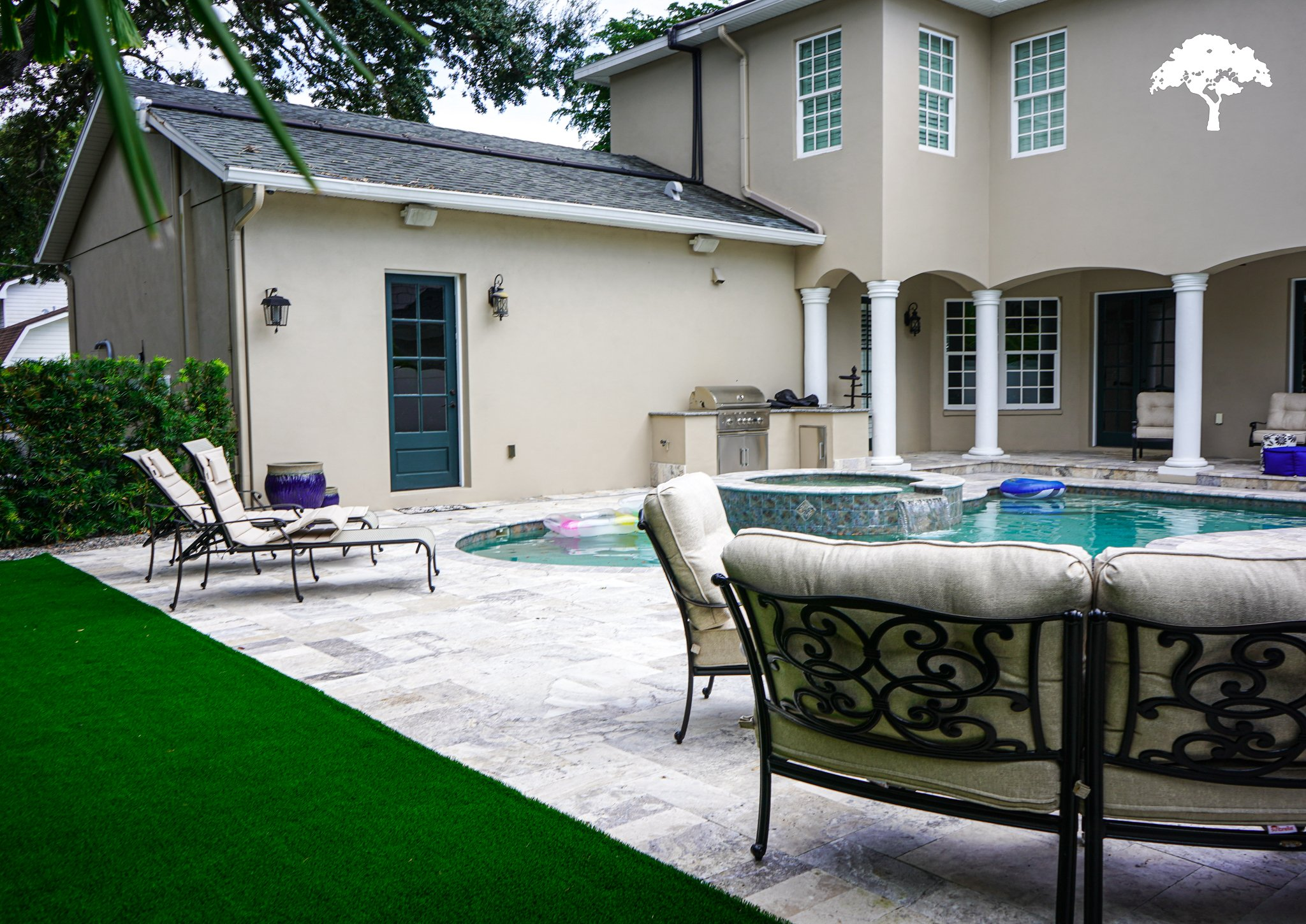 tampa landscape design with artificial turf pavers pool and outdoor kitchen in palma ceia tampa florida